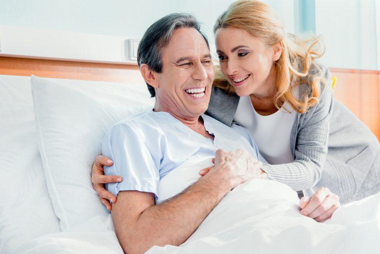 Woman visiting man at a care facility